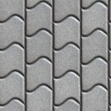 Gray Paving Slabs of the Wavy Form Stock Images