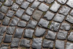 Gray paving stone, with sand, illuminated by the sun, laid out in a semicircle stock images