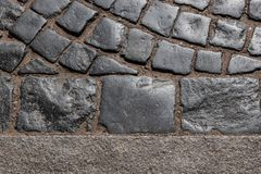 Gray paving stone, with sand, lit by the sun royalty free stock photo