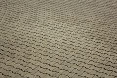 Gray paving stones, angle view. rough surface texture stock photography