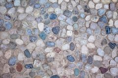 Gray pebble mosaic neutral background. Closeup of neutral colored gray paving stone. Abstract pebble mosaic patterned background stock photos