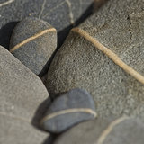 Gray pebble with white line Royalty Free Stock Photo