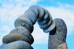 Gray pebbles. Arc of gray pebbles in the balance on the seacoast Royalty Free Stock Image