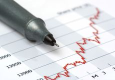 Gray pen on growing share price chart stock images