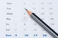 gray pencil on a open calendar business agenda Royalty Free Stock Image