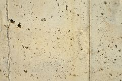 Gray perforated concrete wall texture royalty free stock photos