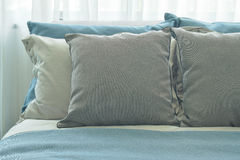 Gray pillows setting on blue color scheme bedding at home. Gray pillows setting on blue color scheme bedding stock photo