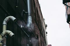 Gray Pipe on Building Wall Stock Photography