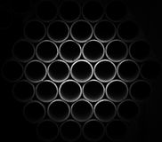 Gray  pipes stacked in construction site Royalty Free Stock Images