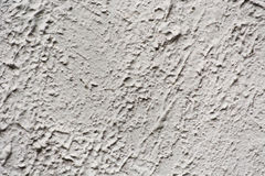 Gray plaster on a wall with cracks Stock Images
