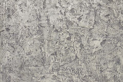 The gray plastered wall. A closeup of a gray plastered walll with interesting texture stock photo