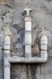 The gray plastic water pipes on the wall Stock Photo