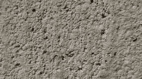 Gray, porous wall from the concrete. Royalty Free Stock Photos
