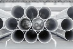 PVC pipes stacked in construction site stock photos