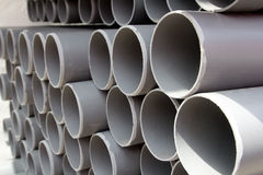 Gray PVC tubes plastic pipes stacked in rows Royalty Free Stock Photo
