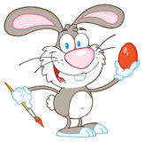 Gray rabbit painting easter egg Royalty Free Stock Photo