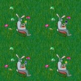 Gray rabbits on rocking chair front grass lawn with easter eggs Stock Photos