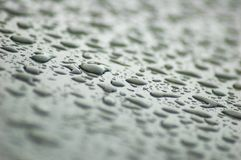 Gray raindrops. On the roof of a car Royalty Free Stock Photography