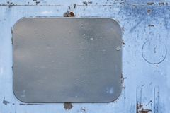 Gray rectangle. Dirty blue paint. Dark cover. Light blue background Royalty Free Stock Photography