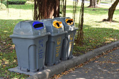 Gray recycle bin, trash bin in the park. Royalty Free Stock Image