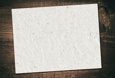 Gray recycled paper is on grunge wooden board Royalty Free Stock Image
