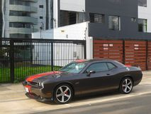 Gray and red Dodge Challenger SRT8 Hemi in Lima. Lima, Peru. March 20, 2016. Front and side  view of a gray and red mint condition Dodge Challenger SRT8 392 Hemi Royalty Free Stock Images