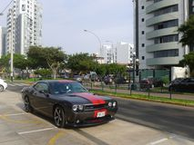 Gray and red Dodge Challenger SRT8 392 Hemi in Lima. Lima, Peru. March 20, 2016.  Front and side  view of a gray and red mint condition Dodge Challenger SRT8 392 Royalty Free Stock Photo