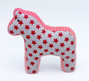 Gray and red textile toy horse with stars and stripes on white Royalty Free Stock Image