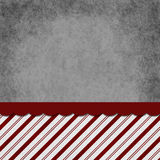 Gray, Red and White Striped Candy Cane Striped Grunge Background. With top copy space for your message Royalty Free Stock Image