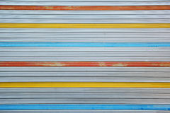 Gray, red, yellow, blue metal sheet slide door texture background. Stock Images