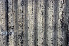 Gray ribbed background of a concrete wall part of a private building. Stone texture of dirty gray concrete wall fencing stock photos