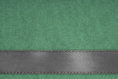 Gray ribbon on green fabric background with copy space. Stock Images