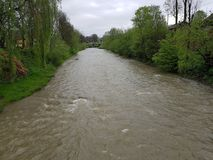 Gray river in the suburbs, floods. Gray river in the suburbs Stock Photo