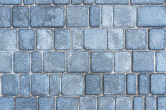 Gray road tiles. Background of gray granite road tiles stock photo