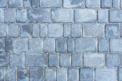 Gray road tiles. Background of gray granite road tiles stock photos