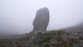 Rock peak in fog Stock Photo