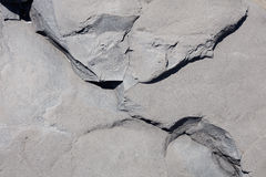 Gray rock stone texture background in sunlight stock photo
