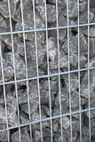 Gray rocks in a cage Stock Photography