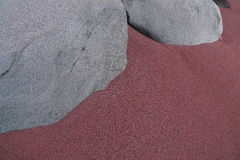 Gray rocks in the reddish sand Royalty Free Stock Image