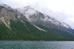 Gray Rocky Mountains Beside Body of Water Royalty Free Stock Image