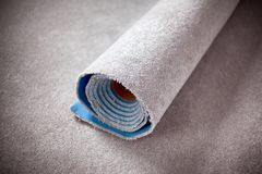 Gray Rolled carpet. Close up stock images