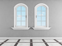 Gray room with two arched windows Stock Images