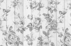 gray rose vintage from fabric on white wooden background Stock Image