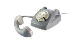 Gray rotary dial phone with removed telephone receiver isolated Stock Photos