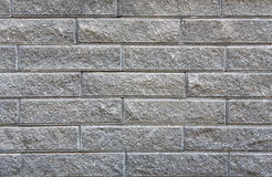 Gray rough brick wall background Royalty Free Stock Photos