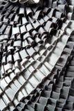 Gray ruffled skirt pleated texture. Fashion background Stock Photos