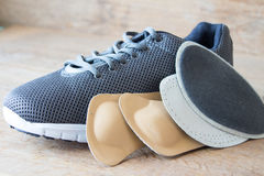 Gray running shoes with orthopedic insoles. Wooden board Royalty Free Stock Images