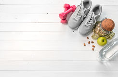 Gray running shoes, space for text on side. Gray running shoes, oats and apples, additional space for text on side Stock Photography