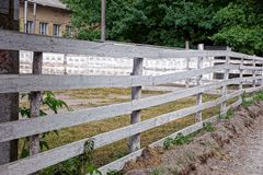Gray rural wooden fence along an empty courtyard Royalty Free Stock Photography