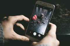 Gray Samsung Smartphone Showing Chocolates Royalty Free Stock Photography